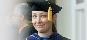 Picture of female wearing graduation cap.